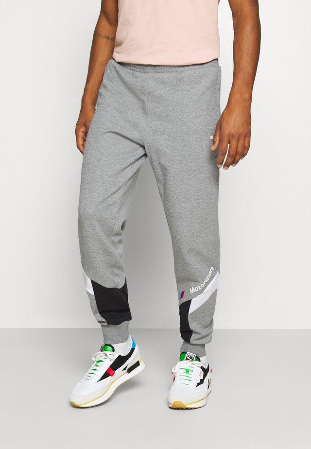 PANTS  - Tracksuit bottoms - medium gray