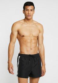 Calvin Klein Swimwear - SHORT DRAWSTRING - Swimming shorts - black - 0