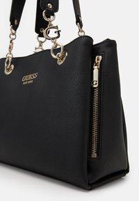 Guess - CHAIN GIRLFRIEND SATCHEL - Handtasche - black - 4