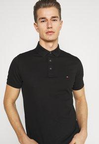 Tommy Hilfiger - Poloshirts - black - 3