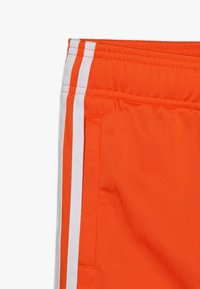 adidas Originals - SUPERSTAR PANTS - Teplákové kalhoty - orange/white - 2