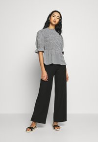 ONLY - ONLNELLA PANT - Trousers - black - 1