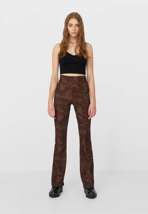 BEDRUCKTE - Trousers - black