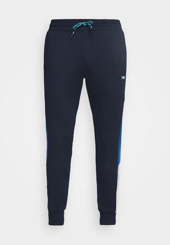 JJIWILL JJCARLING PANTS - Tracksuit bottoms - navy blazer