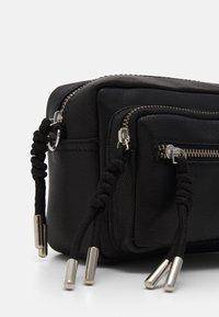 Becksöndergaard - SHEEN MALLY BAG - Across body bag - black - 3