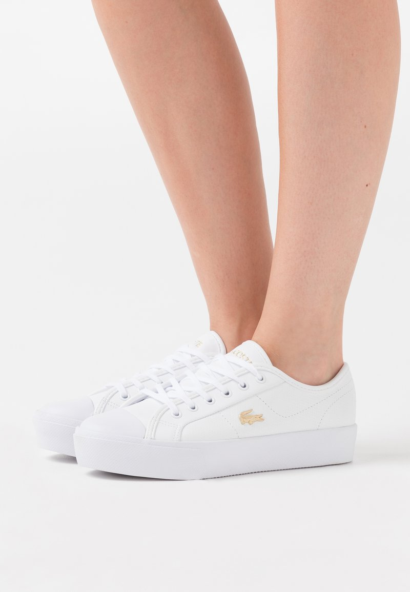 Lacoste - ZIANE PLUS GRAND  - Trainers - white/gold