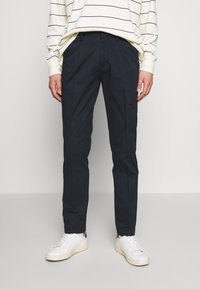 Tommy Hilfiger - TAPERED SUMMER FLEX - Trousers - blue - 0