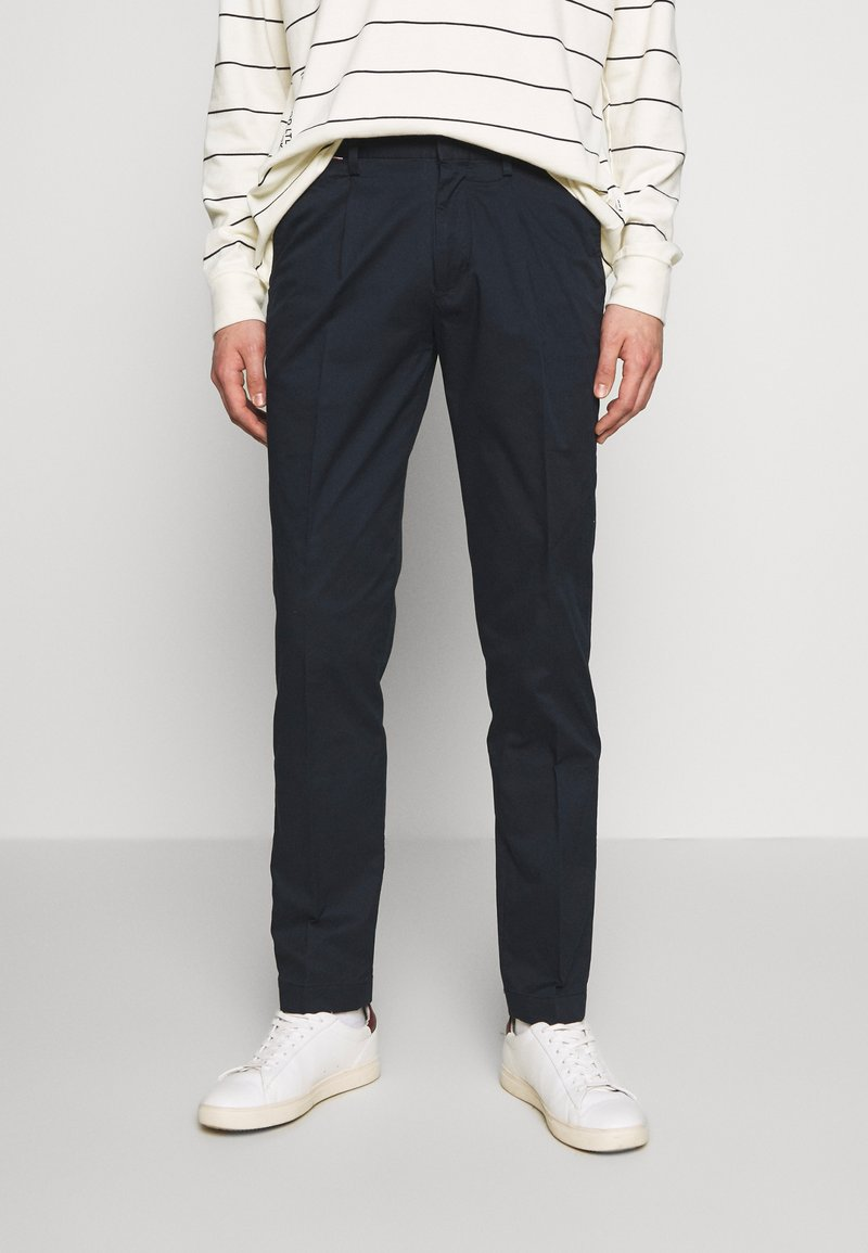 Tommy Hilfiger - TAPERED SUMMER FLEX - Trousers - blue