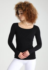 Curare Yogawear - Topper langermet - black - 0