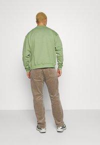 Weekday - SPACE TROUSERS - Trousers - dark beige - 2
