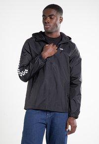 Vans - GARNETT - Training jacket - black-checkerboard - 0