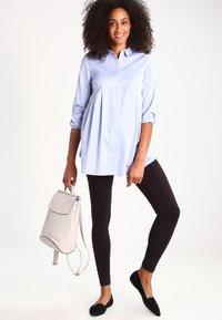 Zalando Essentials Maternity - 2 PACK - Leggings - Trousers - black - 1