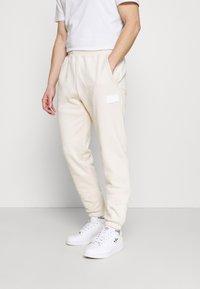 adidas Originals - PANT UNISEX - Verryttelyhousut - halo ivory - 0