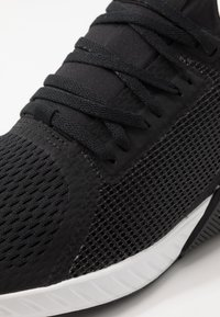 Reebok - FLASHFILM TRAIN - Sports shoes - black/white - 5