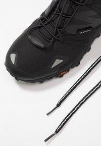 Hi-Tec - V-LITE TRAIL RACER LOW WOMENS - Trail running shoes - black - 5