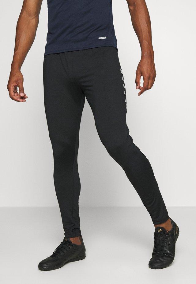 PREMIUM - Pantalones deportivos - schwarz