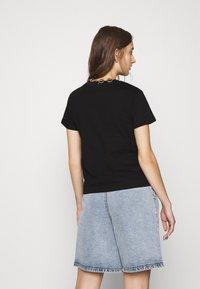 Mavi - BASIC SHORT SLEEVE TOP - Basic T-shirt - black - 2