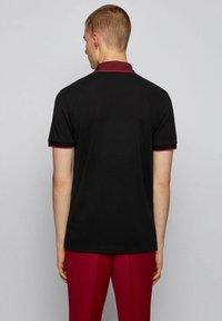 BOSS - Polo shirt - black - 2