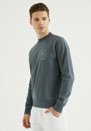 JUST GO - Sweatshirt - turbulence