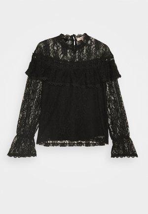 NAIVE - Long sleeved top - black