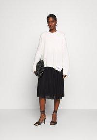 Anna Field - Plisse mesh mini skirt - Áčková sukně - black - 1