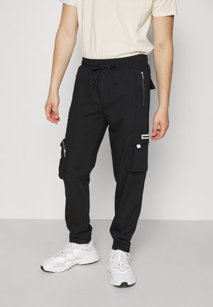 COLLANA TRACK PANTS UNISEX - Reisitaskuhousut - black