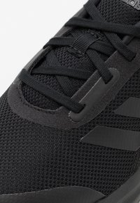adidas Performance - FORTARUN UNISEX - Neutral running shoes - core black/footwear white - 5