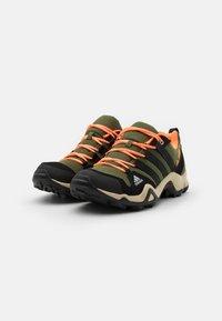 adidas Performance - TERREX AX2R - Hiking shoes - wild pine/core black/screaming orange - 1
