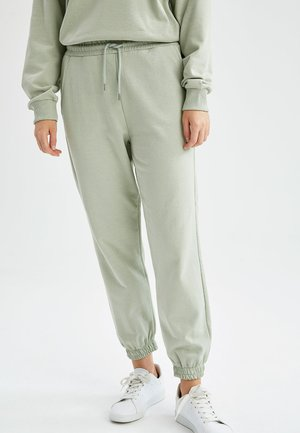 REGULAR FIT  - Tracksuit bottoms - turquoise