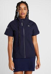 Lacoste Sport - HIGH PERFORMANCE JACKET 2 IN 1 - Outdoorová bunda - navy blue/white - 3