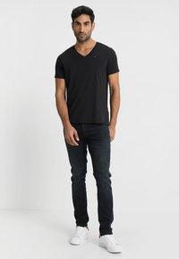 Tommy Jeans - ORIGINAL REGULAR FIT - T-shirt basic - black - 1