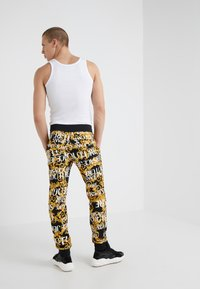 Versace Jeans Couture - PANTALONE - Tracksuit bottoms - nero - 2