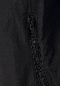 Nike Sportswear - TRACK - Kevyt takki - black/white - 3