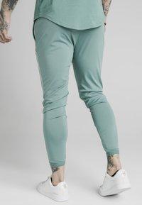 SIKSILK - Pantaloni sportivi - light petrol blue - 1