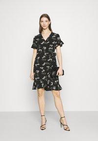 Vero Moda - VMSAGA WRAP FRILL DRESS  - Vestido informal - black - 1