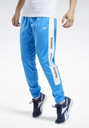 TRAINING ESSENTIALS TRACK JOGGERS - Tracksuit bottoms - blue