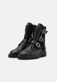 Stuart Weitzman - SYDNEY LIFT - Korte laarzen - black - 1