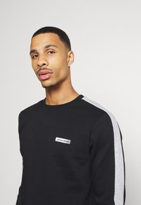 Jack & Jones Performance - JCOZ SPORT CREW NECK - Sweatshirt - black - 3
