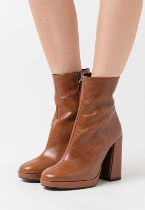 BABYLON - High heeled ankle boots - cognac