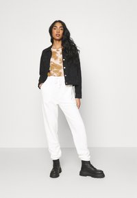 Topshop - TOWELLING - Tracksuit bottoms - white - 1
