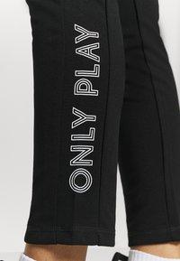 ONLY Play - ONPNYLAH SLIM PANTS - Tracksuit bottoms - black/white - 4