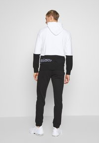 Champion - CUFF PANTS - Trainingsbroek - black - 2