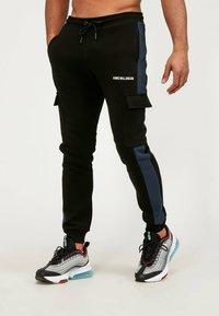 Kings Will Dream - Cargo trousers - black/navy - 3
