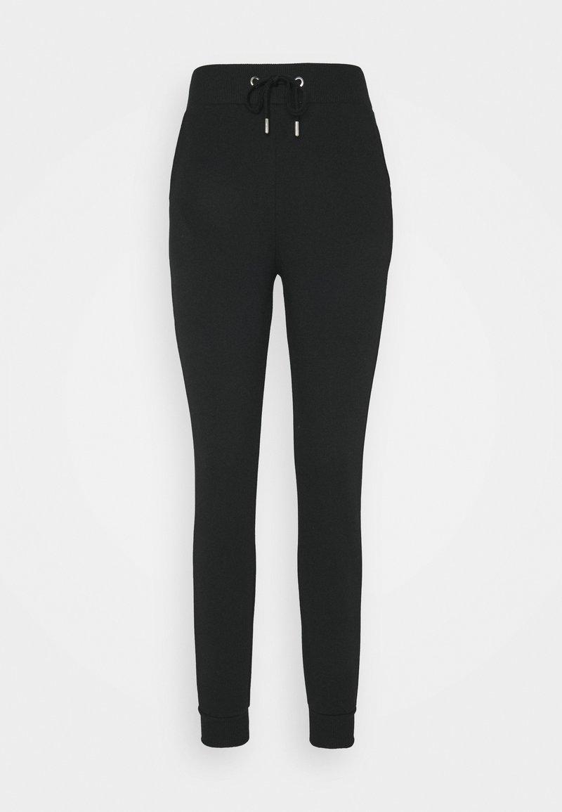 NU-IN - Tracksuit bottoms - black