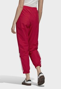 adidas Originals - PAOLINA RUSSO - Pantalon de survêtement - scarlet - 1