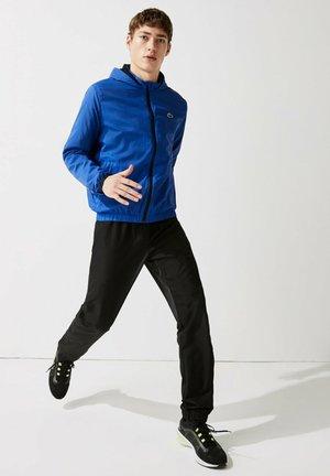 Veste de survêtement - bleu / noir / blanc