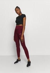 Nike Performance - EPIC LUX RUNWAY - Leggings - dark beetroot - 1