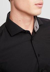 Seidensticker - SLIM FIT - Formal shirt - black - 5