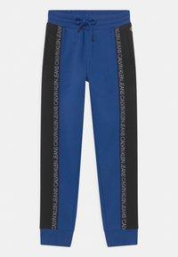 Calvin Klein Jeans - COLOUR BLOCK  - Pantalones deportivos - blue - 0