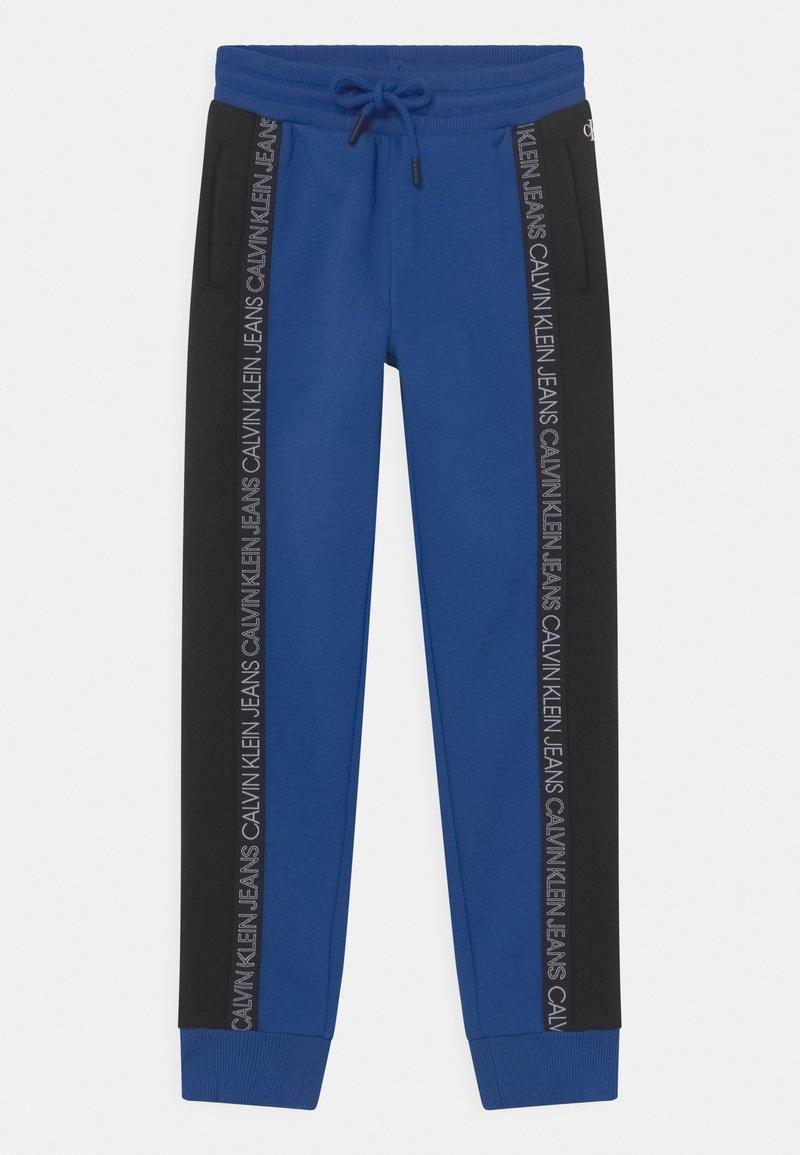 Calvin Klein Jeans - COLOUR BLOCK  - Pantalones deportivos - blue